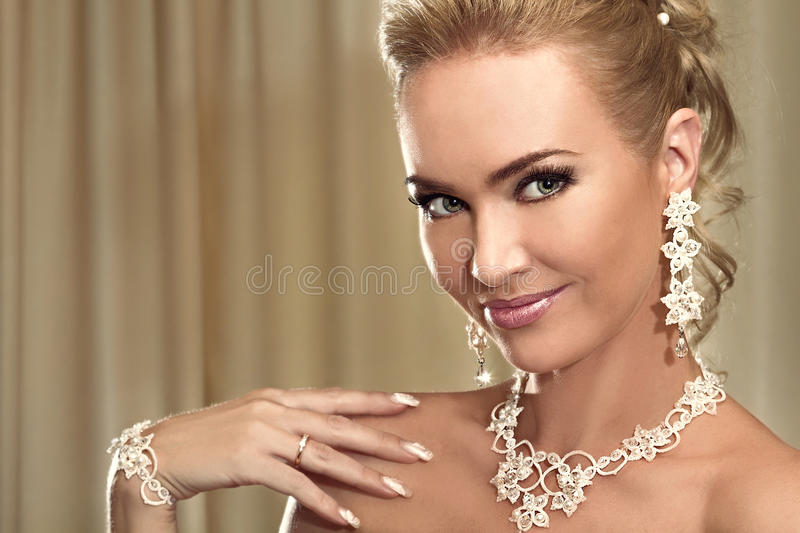 Close-up portrait of the happy beautiful bride showing a wedding royalty free stock photo