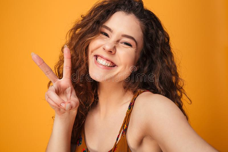 Close up portrait of a happy curly haired girl royalty free stock image