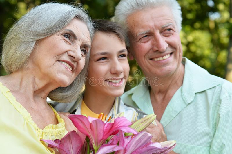 Close up portrait of happy grandfather, grandmother and grandson stock photos