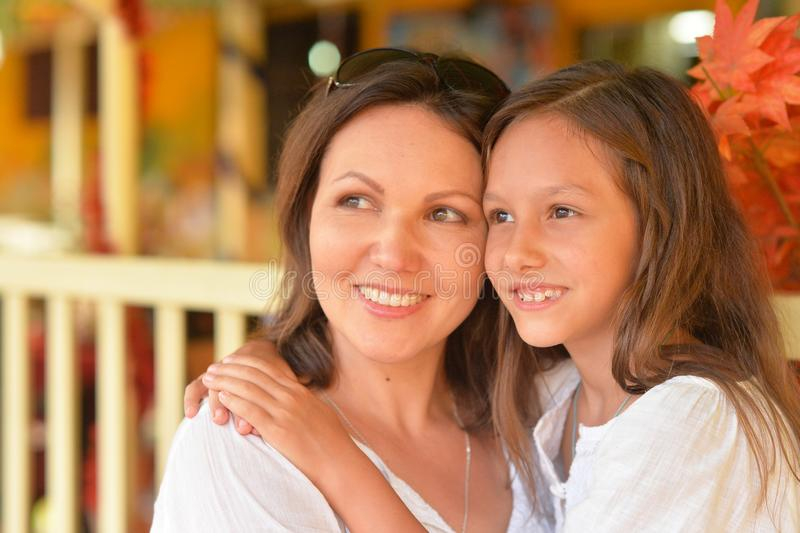 Close up portrait of happy mother and daughter hugging stock images