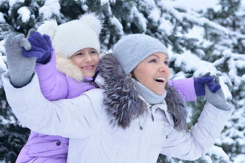 Portrait of happy mother and daughter in winter stock photos