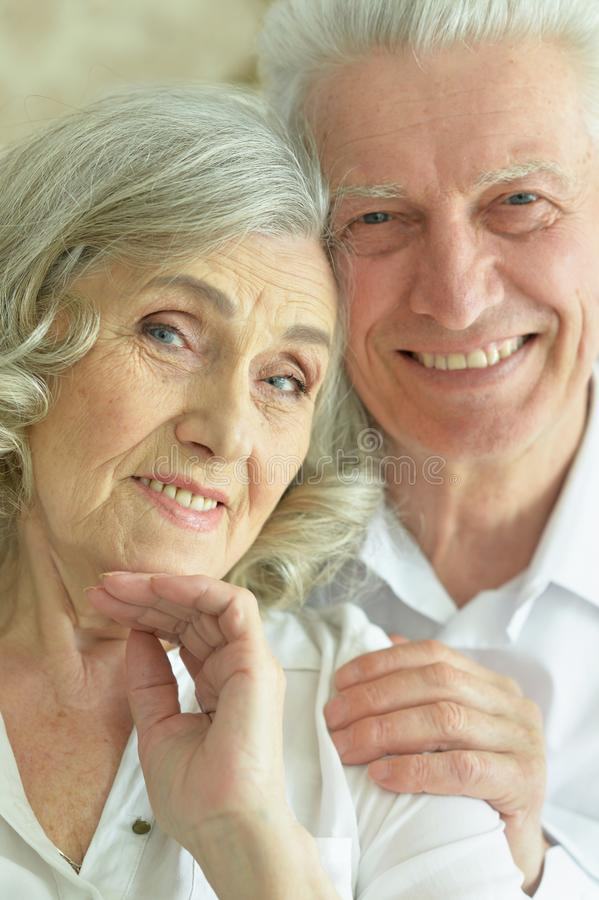 Close up portrait of happy senior couple posing royalty free stock images