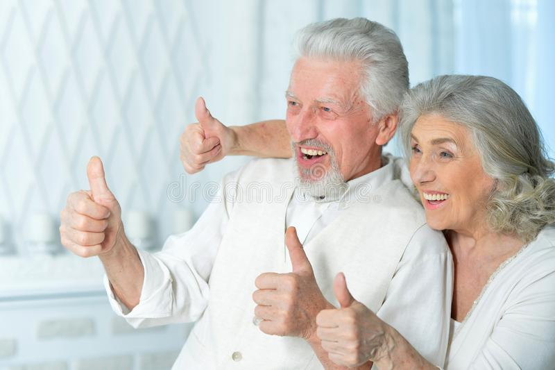 Close up portrait of happy senior couple with thumbs up royalty free stock image