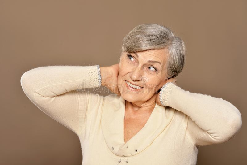 Close up portrait of happy senior woman at home stock photography