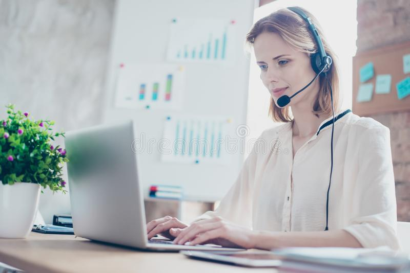 Close up portrait of happy smiling confident experienced qualified young professional operator of call center, she is sitting royalty free stock photography