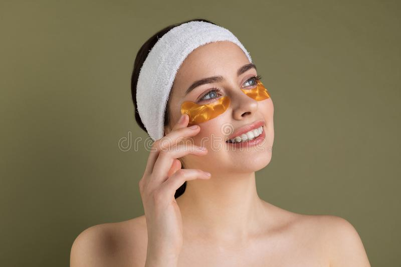 Close up portrait of happy smiling girl with patches under eyes from wrinkles and dark cicles stock image