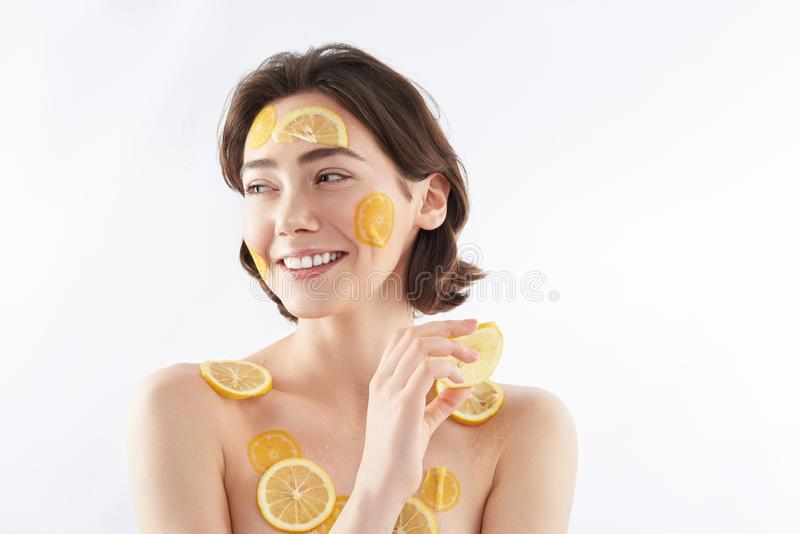 Happy woman with lemon pieces on body royalty free stock photography