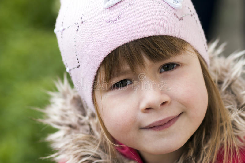 Close-up portrait of happy smiling pretty little girl royalty free stock photography
