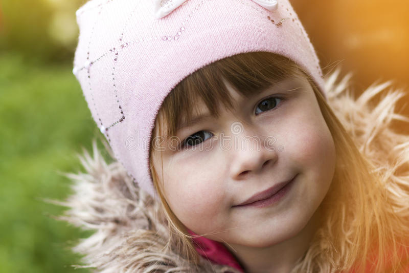 Close-up portrait of happy smiling pretty little girl. Soft light effect stock photos