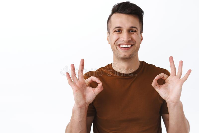 Close-up portrait of happy, smiling satisfied male customer, guy showing okay signs in approval, agree or like good. Quality service provided by company stock images