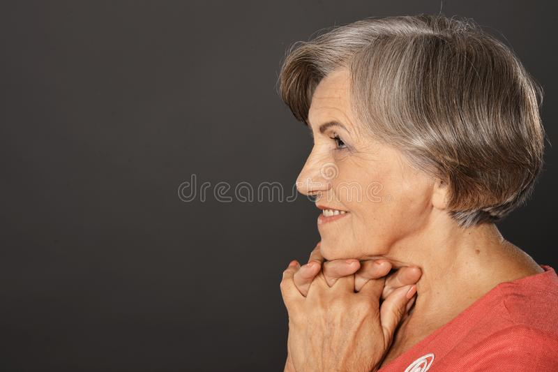 Close up portrait of happy smiling senior woman posing royalty free stock photography