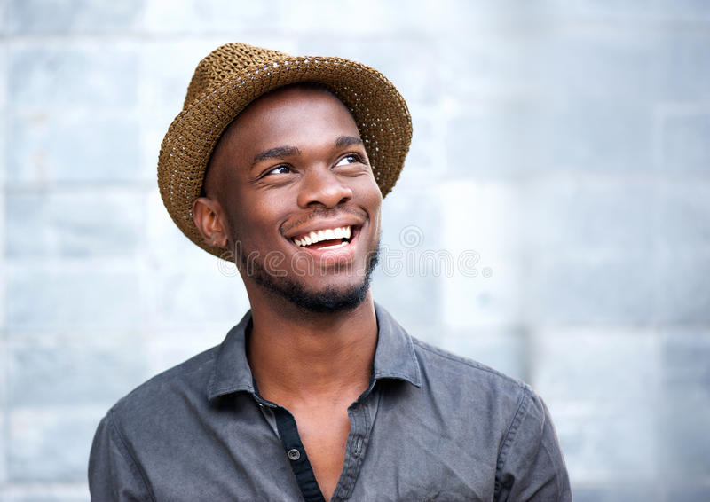 Close up portrait of a happy young african american man laughing royalty free stock photos