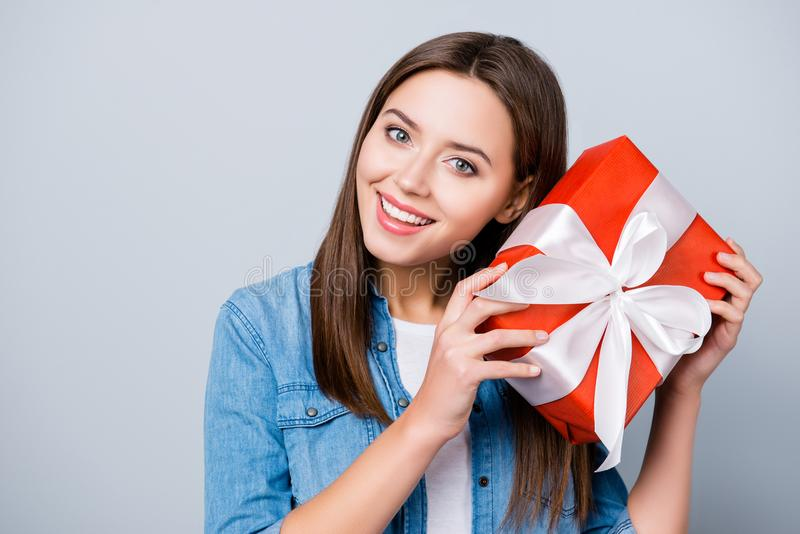 Close up portrait of happy, young, cute woman holding gift in r stock photography