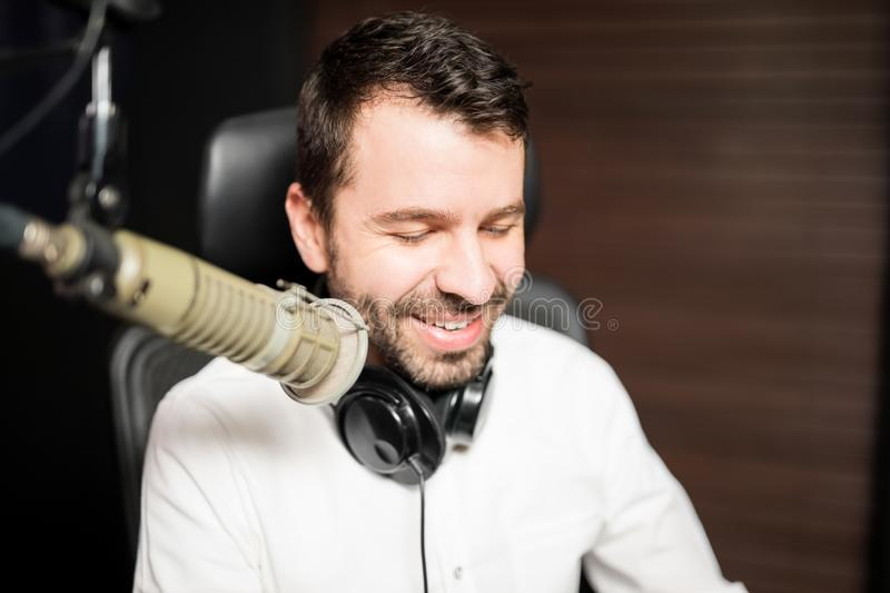 Male broadcaster at radio station royalty free stock photography
