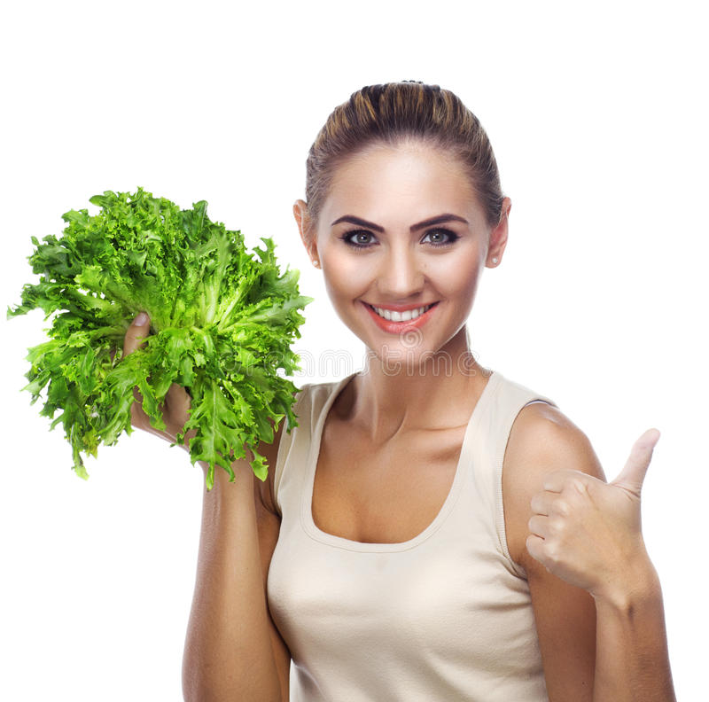 Close-up portrait of happy young woman with bundle herbs (salat stock photography