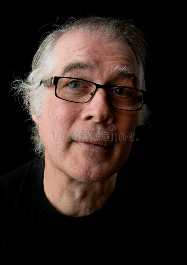 Close up portrait headshot of a senior man in his 50`s. male we stock images