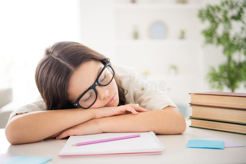 Close-up portrait of her she nice attractive charming cute intellectual diligent wavy-haired pre-teen girl tired of royalty free stock photography