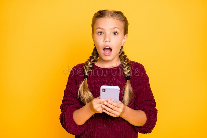 Close-up portrait of her she nice attractive lovely wondered astonished stunned pre-teen girl using cell media reaction. Close-up portrait of her she nice royalty free stock photography