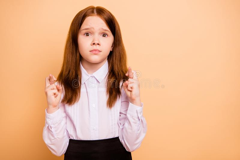 Close-up portrait of her she nice attractive lovely worried pre-teen girl holding crossed fingers anticipation news. Close-up portrait of her she nice attractive royalty free stock images