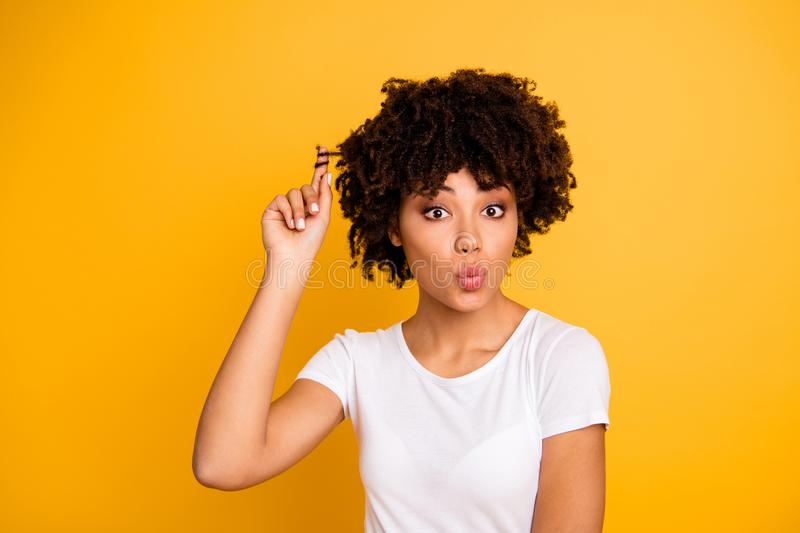 Close-up portrait of her she nice cute attractive girlish funny cheerful flirty coquette wavy-haired lady playing with. Curls sending air blow kiss isolated on stock photo