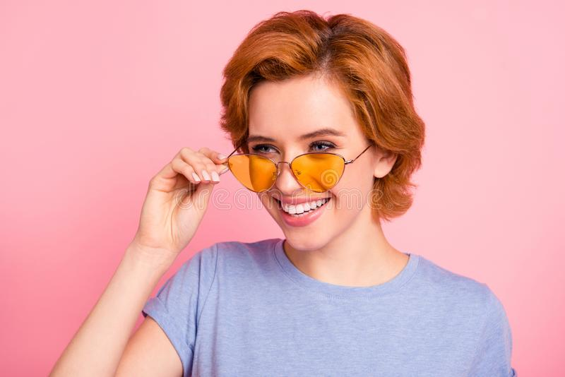 Close-up portrait of her she nice cute charming attractive lovely feminine cheerful optimistic girl wearing casual blue. T-shirt yellow glasses  over pink royalty free stock photo