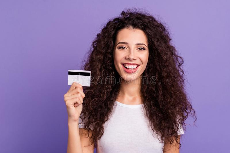 Close-up portrait of her she nice cute lovely attractive cheerful cheery wavy-haired lady using new modern card purchase stock photo