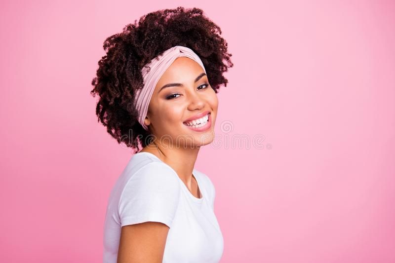 Close-up portrait of her she nice-looking attractive charming cute lovely winsome adorable magnificent cheerful cheery. Wavy-haired girl isolated over pink royalty free stock image