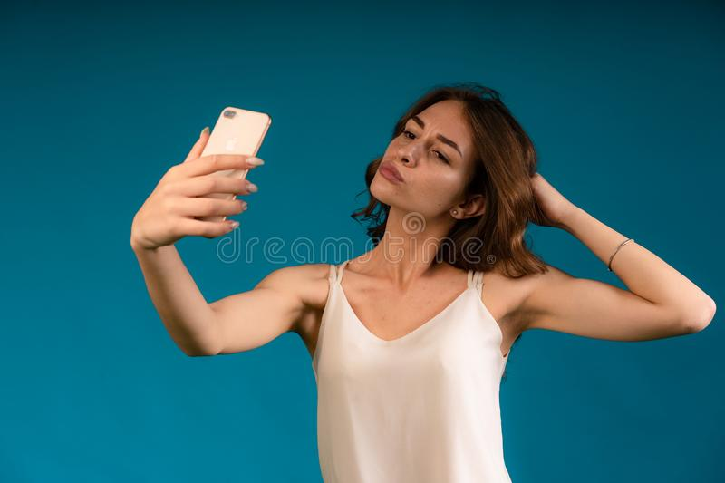 Close-up portrait of her she nice-looking charming attractive lovely winsome fascinating cheerful cheery straight-haired lady. Making taking selfie  over bright royalty free stock photo