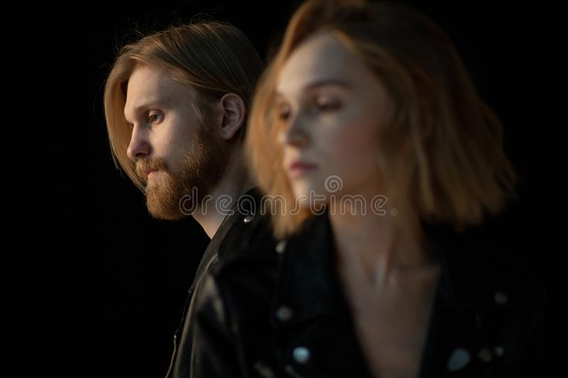 Close up portrait of hipster couple in black leather jackets stock images