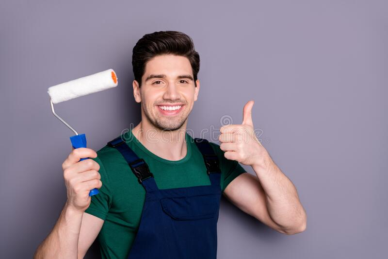 Close-up portrait of his he nice attractive brunette cheerful cheery glad guy making renovation new design holding in. Close-up portrait of his he nice stock photo