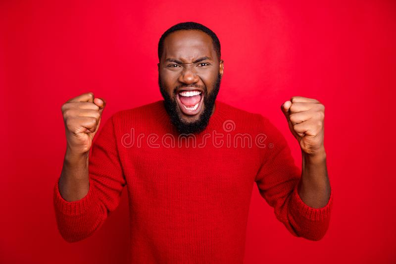 Close-up portrait of his he nice attractive cheerful cheery ecstatic glad bearded guy fan holding fists great attainment. Close-up portrait of his he nice royalty free stock images