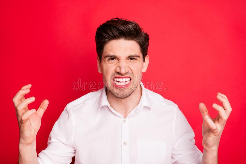 Close-up portrait of his he nice attractive enraged savage wild evil gloomy grumpy sullen guy showing negative bad mood stock photo