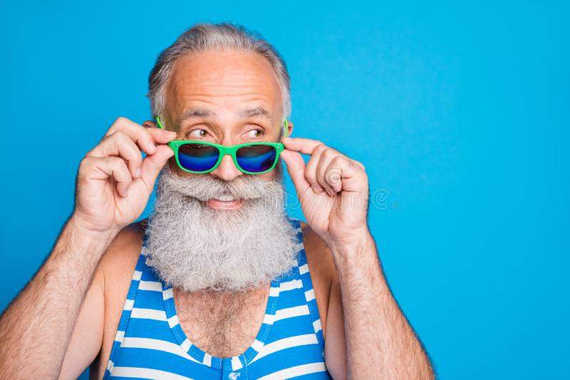 Close-up portrait of his he nice attractive funky cheerful cheery content gray-haired man spending leisure cool carefree. Close-up portrait of his he nice stock images