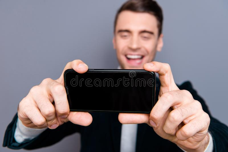 Close-up portrait of his he nice attractive handsome bearded cheerful cheery guy wearing velveteen blazer making taking. Selfie photo capture isolated over gray royalty free stock photo