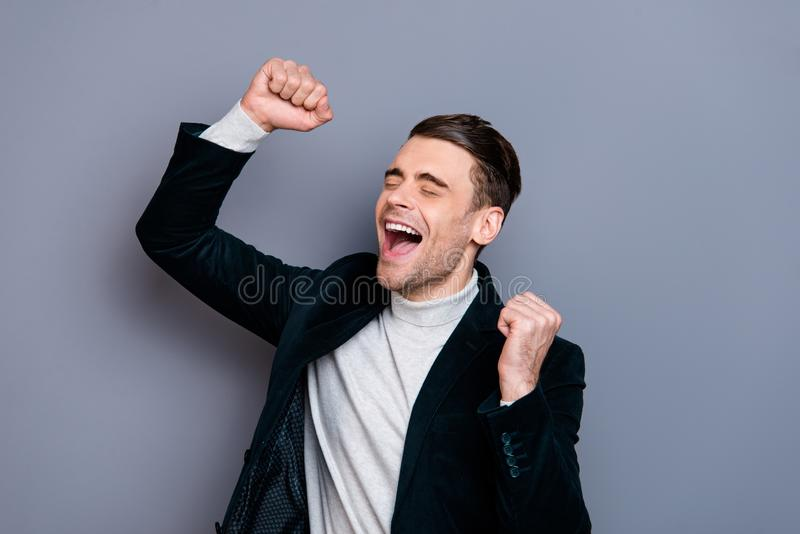 Close-up portrait of his he nice cute handsome attractive cheerful cheery overjoyed guy wearing velveteen blazer sweater. Celebrating winning isolated over gray stock images