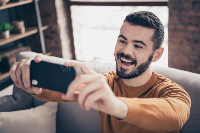 Close-up portrait of his he nice-looking attractive cheerful cheery glad positive bearded guy taking making selfie post stock images