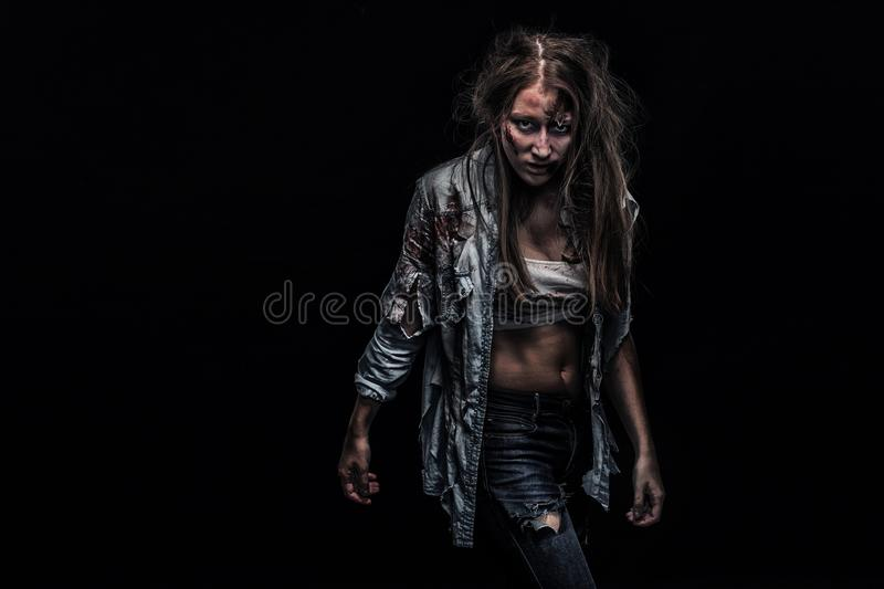 Zombie woman, Horror background for halloween concept and book cover. Copy space. Close-up portrait of a horrible scary zombie woman. Horror. Halloween poster stock photos