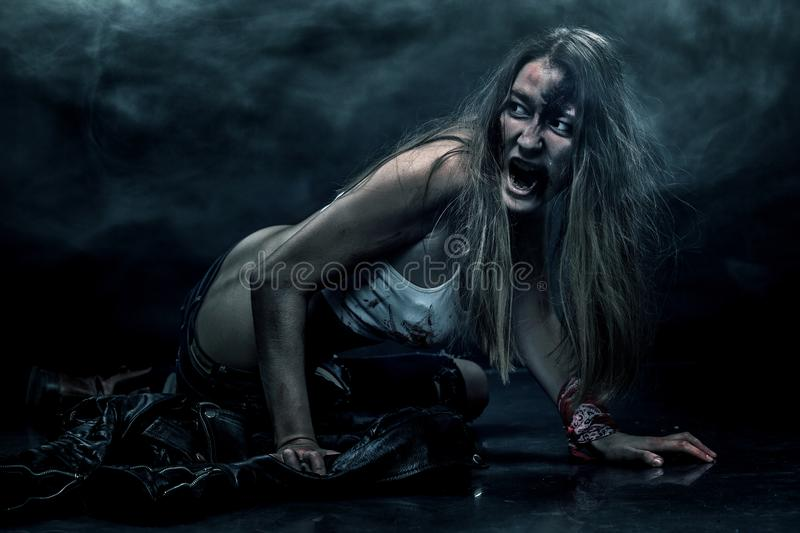 Zombie woman, Horror background for halloween concept and book cover. Copy space. Close-up portrait of a horrible scary zombie woman. Horror. Halloween poster royalty free stock photo