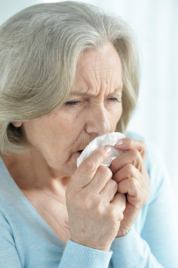 Close-up portrait of ill senior woman coughing stock images