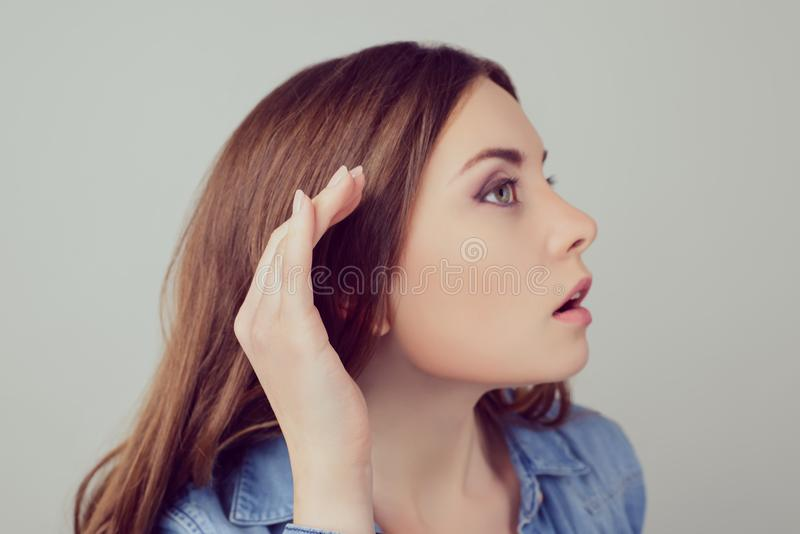 Close up portrait of interested nosy newsy beautiful woman wants royalty free stock photography