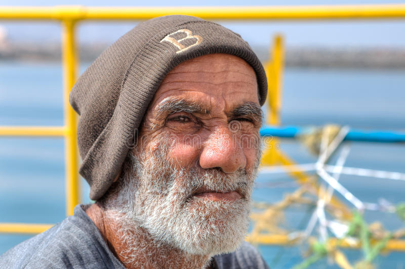 Close-up portrait of an Iranian old man laborer. royalty free stock photography