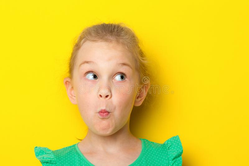 Close-up portrait of a little amazing girl with blue eyes and opening mouth royalty free stock photos