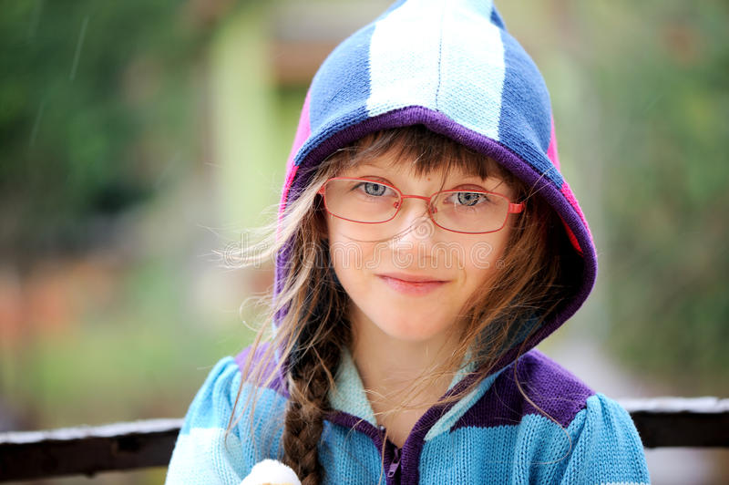 Close-up portrait of little girl in a hoody stock photography