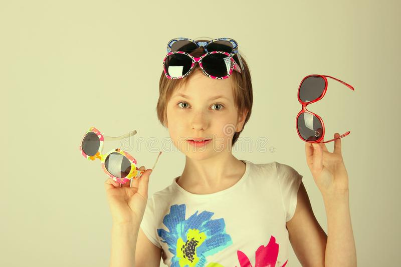 Close-up portrait of a little girl wearing funky sunglasses. Young teenage girl wearing stylish sunglasses. Adorable Girl Wearing sunglasses. Portrait of a royalty free stock photography