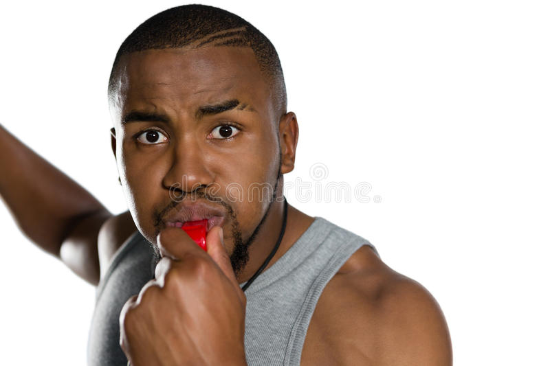 Close up portrait of male instructor blowing whistle royalty free stock photo
