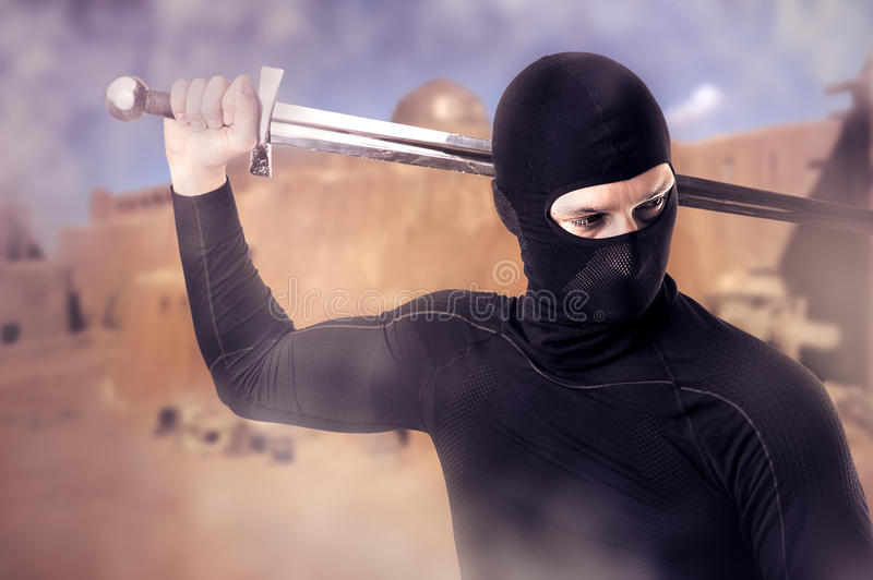 Ninja with sword outdoor in smoke royalty free stock image