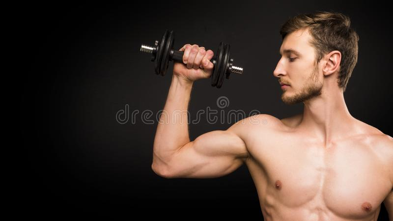 Close up portrait of a man with dumbell royalty free stock image