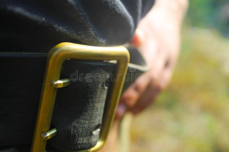 Close up portrait of a man holding his belt royalty free stock photos