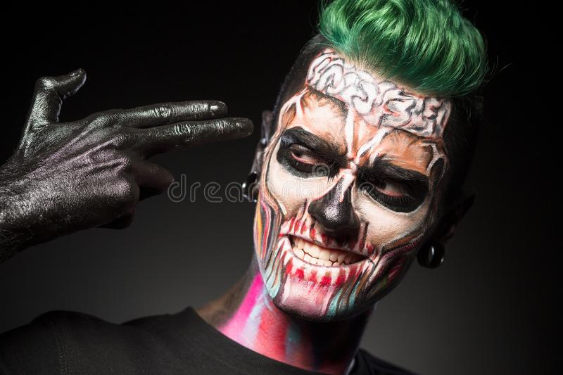 Close up portrait of a man with mystical halloween makeup. royalty free stock image