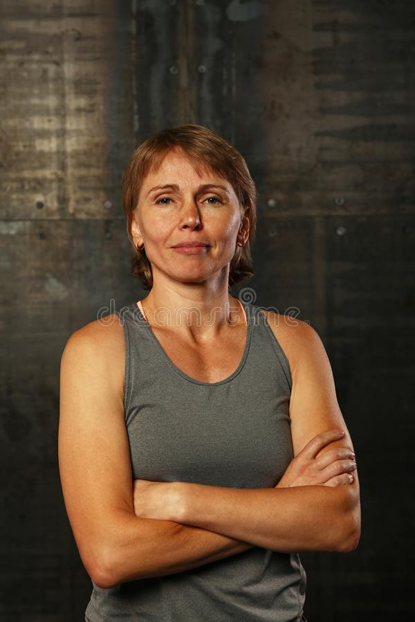 Close up portrait of middle age athletic woman royalty free stock image